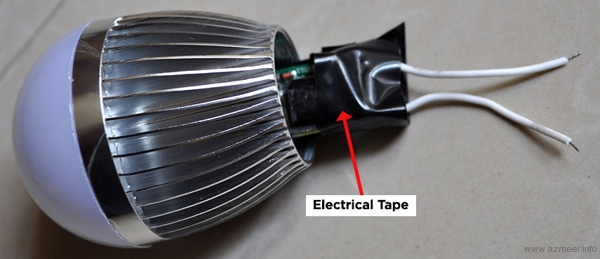 Driver circuit wrapped in electrical tape to prevent short circuit with the heat sink